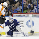 Tampa Bay Lightning goalie Anders Lindback (39), of Sweden, makes a glove save on a shot by Philadelphia Flyers right wing Wayne Simmonds (17) during the second period of an NHL hockey game Thursday, April 10, 2014, in Tampa, Fla The Associated Press