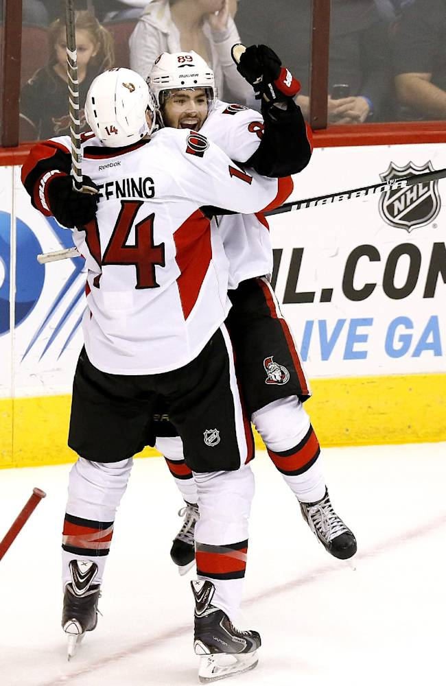 Ottawa Senators' Cory Conacher (89) celebrates his game-winning goal against the Phoenix Coyotes with teammate Colin Greening during overtime in an NHL hockey game on Tuesday Oct. 15, 2013, in Glendale, Ariz.  The Senators defeated the Coyotes 4-3 in overtime