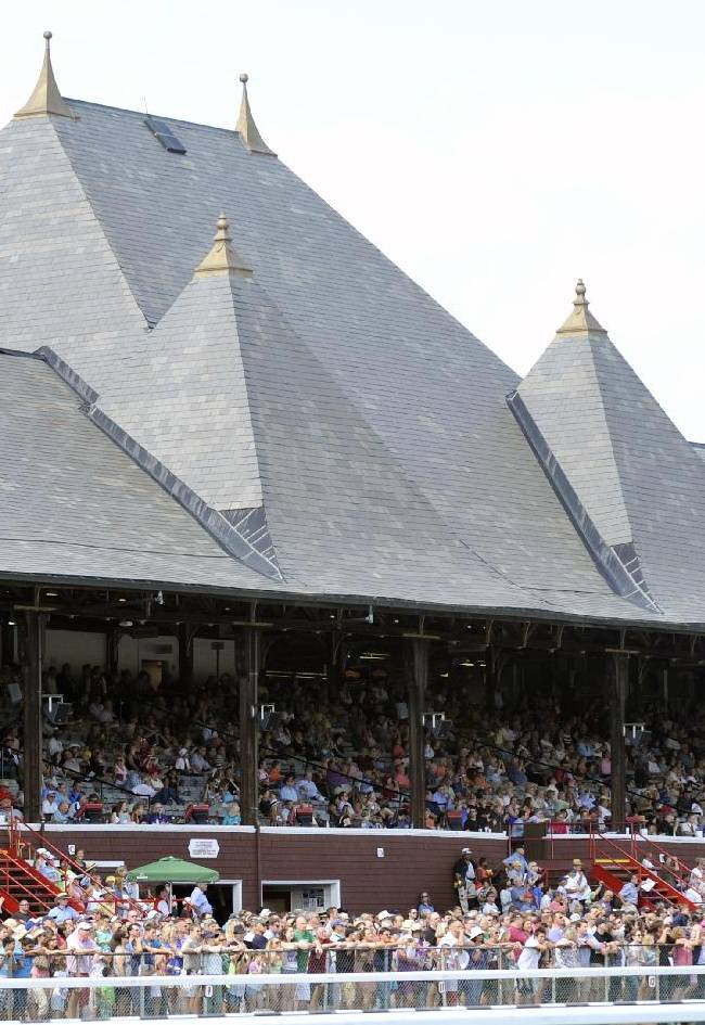 Fans fill the grandstand on opening day of the horse racing season at Saratoga Race Course in Saratoga Springs, N.Y., Friday, July 18, 2014
