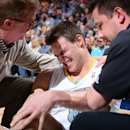 DENVER, CO - APRIL 4: Danilo Gallinari #8 of the Denver Nuggets speaks with trainers after a knee injury in a game against the Dallas Mavericks on April 4, 2013 at the Pepsi Center in Denver, Colorado. (Photo by Garrett W. Ellwood/NBAE via Getty Images)