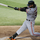 San Francisco Giants' Brandon Crawford swings on an RBI single off Colorado Rockies starting pitcher Jordan Lyles in the fourth inning of the first game of a baseball doubleheader Saturday, May 23, 2015, in Denver. (AP Photo/David Zalubowski)