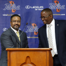 New Tulsa head basketball coach Frank Haith, left, is introduced by Tulsa director of athletics Derrick Gragg, right, in Tulsa, Okla., Friday, April 18, 2014 The Associated Press