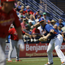 New York Mets' David Wright throws to first base after fielding a sacrifice bunt by St. Louis Cardinals' Peter Bourjos, left, in the first inning of an exhibition spring training baseball game, Wednesday, March 12, 2014, in Port St. Lucie, Fla The Associa