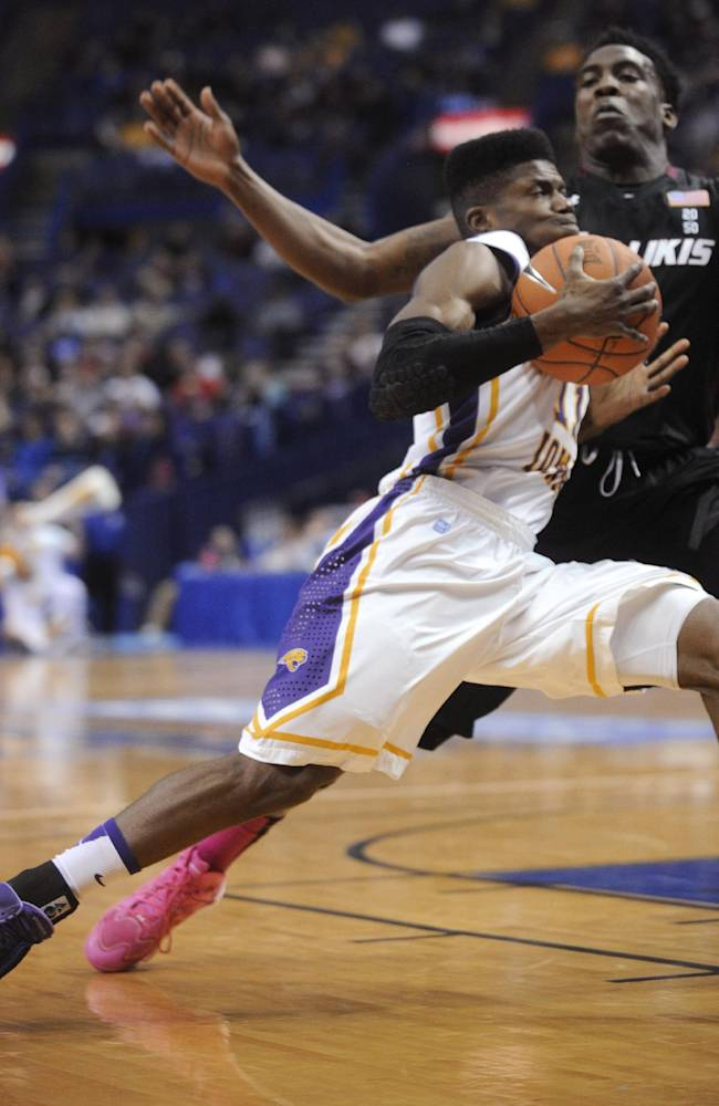 Northern Iowa's Wes Washpun, left, drives into Southern Illinois' Jalen Pendelton, right, during the first half of an NCAA college basketball game in the quarterfinals of the Missouri Valley Conference men's tournament, Friday, March 7, 2014, in St. Louis