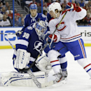 Montreal Canadiens right wing Dale Weise, right, looks for a rebound as Tampa Bay Lightning goalie Anders Lindback (39), of Sweden, makes a save during the first period of Game 2 of a first-round NHL hockey playoff series on Friday, April 18, 2014, in Tam