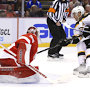 Boston Bruins center David Krejci (46), of the Czech Republic, scores against Detroit Red Wings goalie Jimmy Howard (35) in the first period of an NHL hockey game in Detroit, Wednesday, Oct. 15, 2014 The Associated Press
