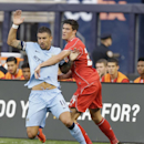 Liverpool's Martin Kelly (34) and Manchester City's Aleksandar Kolarov (11) fight for the ball in the first half of a Guinness International Champions Cup soccer tournament match Wednesday, July 30, 2014, in New York