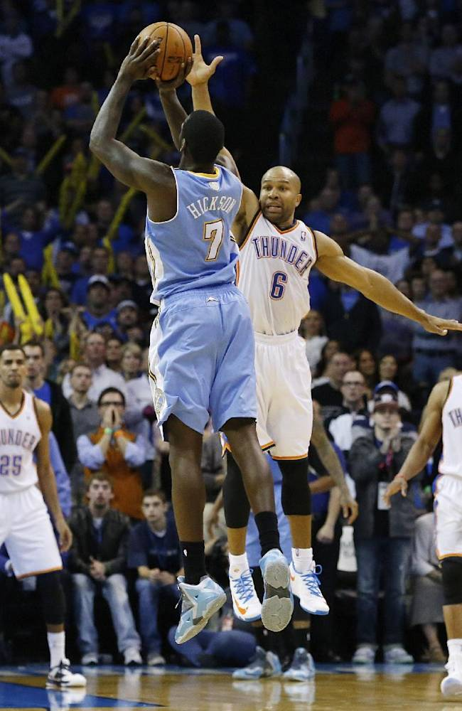 Denver Nuggets forward J.J. Hickson (7) attempts at shot over Oklahoma City Thunder guard Derek Fisher (6) in the final seconds of the fourth quarter of an NBA basketball game, but misses the basket in Oklahoma City, Monday, Nov. 18, 2013. Oklahoma City won 115-113