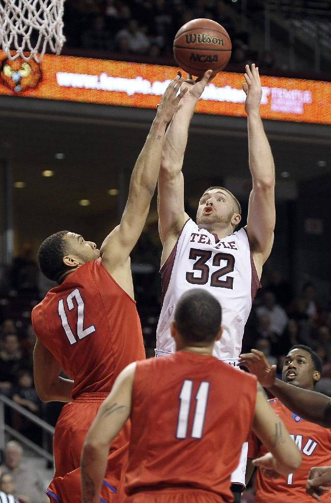 Temple's Dalton Pepper (32) takes a shot over SMU's Nick Russell (12) during the second half of an NCAA college basketball game on Sunday, Feb. 16, 2014, in Philadelphia. Temple won 71-64