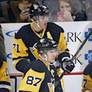 Pittsburgh Penguins' Sidney Crosby (87) and Evgeni Malkin (71) take the ice for a power play during the first period of an NHL hockey game against the Colorado Avalanche in Pittsburgh on Thursday, Dec. 18, 2014 The Associated Press