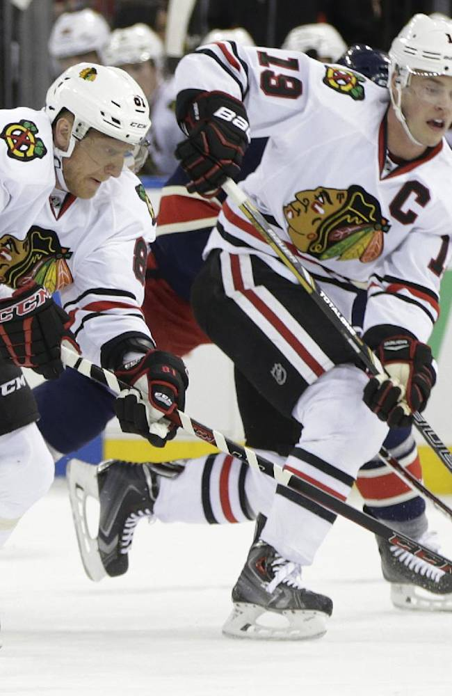 Chicago Blackhawks right wing Marian Hossa (81), of Slovakia, and center Jonathan Toews (19) move the puck down the ice during the first period of an NHL hockey game against the New York Rangers at Madison Square Garden in New York, Thursday, Feb. 27, 2014