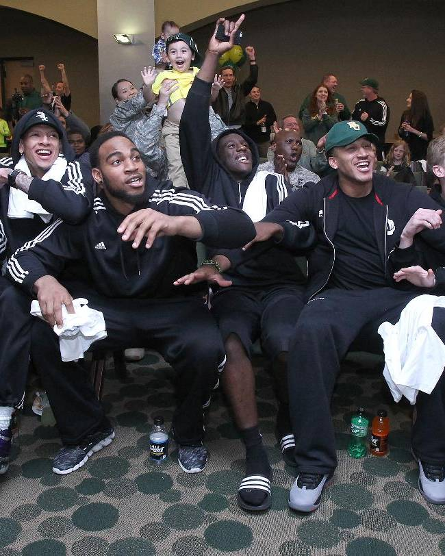 In this Sunday, March 16, 2014 photo, Baylor  players Isaiah Austin, left,  Rico Gathers, Taurean Prince, Ish Wainright and Logan Lowery, right, react after being selected to play in the West region of the NCAA tournament during a Selection Sunday watch party in Waco, Texas