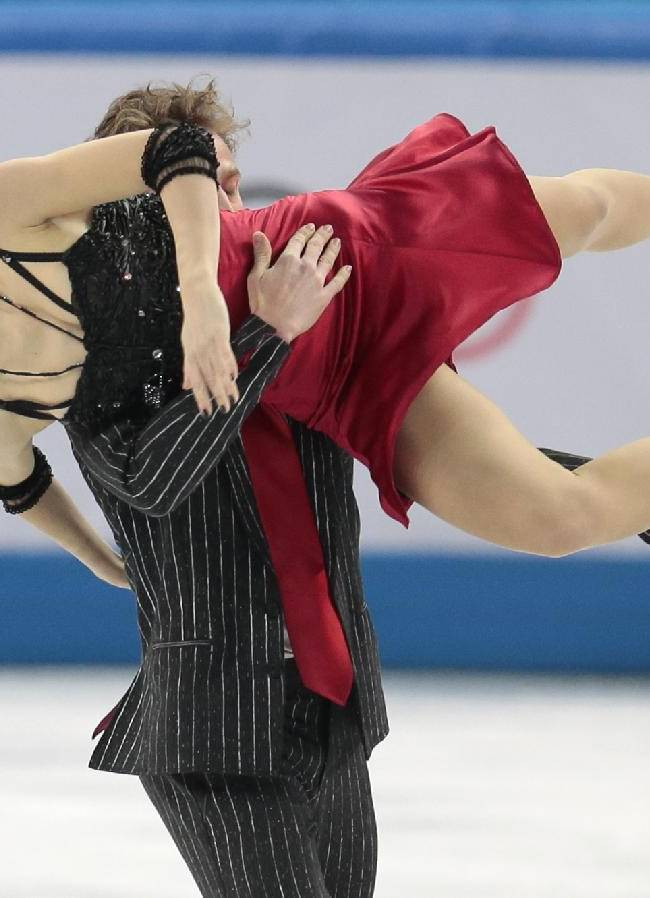 Nathalie Pechalat and Fabian Bourzat of France compete in the team ice dance short dance figure skating competition at the Iceberg Skating Palace during the 2014 Winter Olympics, Saturday, Feb. 8, 2014, in Sochi, Russia