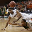 Virginia guard Jontel Evans (1) and Norfolk State guard Malcolm Hawkins, right, struggle for a loose ball during the first half of a first-round NIT college basketball game in Charlottesville, Va., Tuesday, March 19, 2013. (AP Photo/Steve Helber)