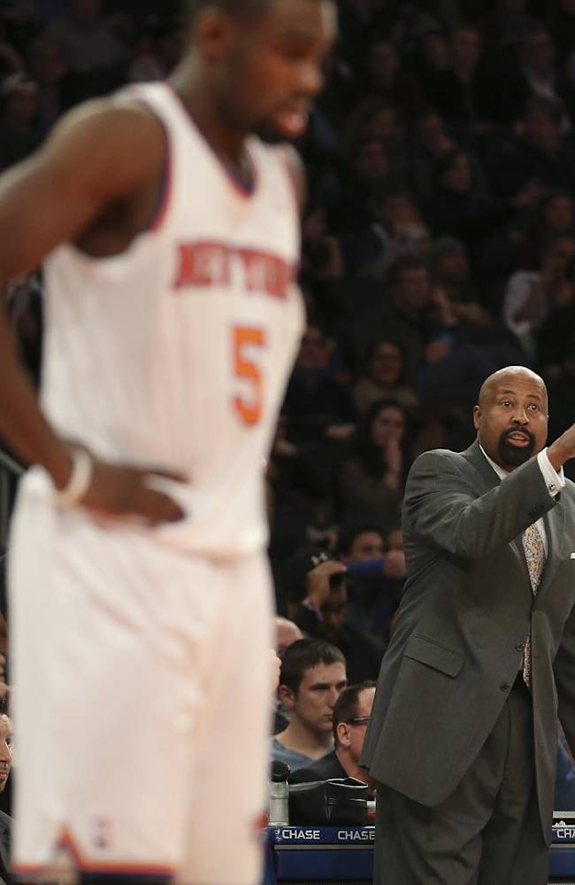 New York Knicks head coach Mike Woodson directs his players as guard Tim Hardaway Jr. (5) waits for play to begin during the second half of an NBA basketball game against the Atlanta Hawks, Saturday, Dec. 14, 2013, in New York. The Knicks won 111-106