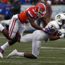 East Carolina wide receiver Isaiah Jones (7) catches a pass as he is tackled by Florida defensive back Keanu Neal (42) during the first half of the Birmingham Bowl NCAA college football game, Saturday, Jan. 3, 2015, in Birmingham, Ala The Associated Press