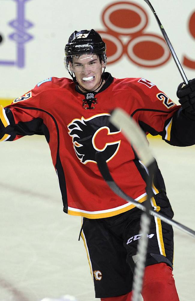 Calgary Flames' Sean Monahan celebrates scoring the go-ahead goal against the New Jersey Devils during the third period of an NHL hockey game Friday, Oct. 11, 2013, in Calgary, Alberta. The Flames won 3-2