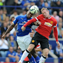 Manchester United's Wayne Rooney, right, battles for the ball with Leicester's Wes Morgan during the English Premier League soccer match between Leicester City and Manchester United at King Power Stadium, in Leicester, England, Sunday, Sept. 21, 2014