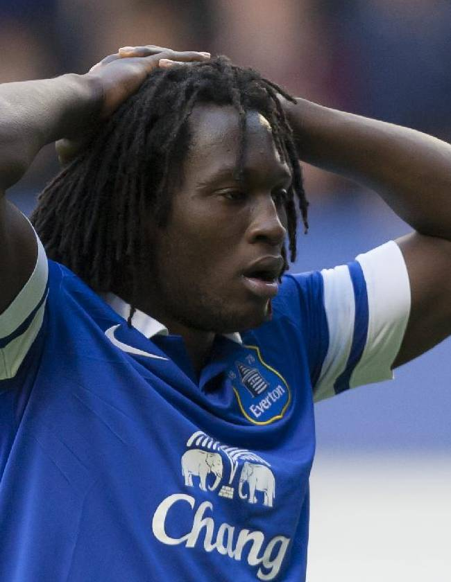 Everton's Romelu Lukaku who scored two of his side's goals holds his head in his hands after his team's 3-3 draw against Liverpool during their English Premier League soccer match at Goodison Park Stadium, Liverpool, England, Saturday Nov. 23, 2013