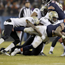 Chicago Bears running back Matt Forte (22) is stopped by New Orleans Saints cornerback Keenan Lewis (28) and defensive end Akiem Hicks (76) during the first half of an NFL football game Monday, Dec. 15, 2014, in Chicago The Associated Press