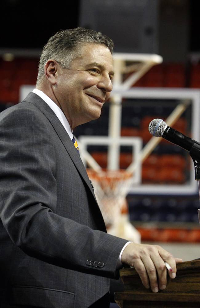 Auburn's new men's basketball coach, Bruce Pearl, speaks Tuesday, March 18, 2014, in Auburn, Ala. Auburn hired Pearl to revive a struggling basketball program that hasn't been to the NCAA tournament in more than a decade