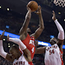 Atlanta Hawks forward Paul Millsap (4) drives to the hoop past Toronto Raptors guard Terrence Ross, left, and forward Patrick Patterson (54) during first-half NBA basketball game action in Toronto, Wednesday, Feb. 12, 2014 The Associated Press