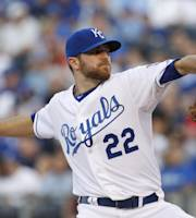 Kansas City Royals pitcher Wade Davis throws to a batter in the first inning of a baseball game against the Miami Marlins at Kauffman Stadium in Kansas City, Mo., Monday, Aug. 12, 2013. (AP Photo/Colin E. Braley)