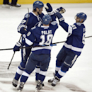 Tampa Bay Lightning's Ondrej Palat (18) and Valterri Flippula (51) congratulate Victor Hedman, left, after his goal against the Ottawa Senators during the first period of an NHL hockey game Saturday, Oct. 11, 2014 in Tampa, Fla The Associated Press