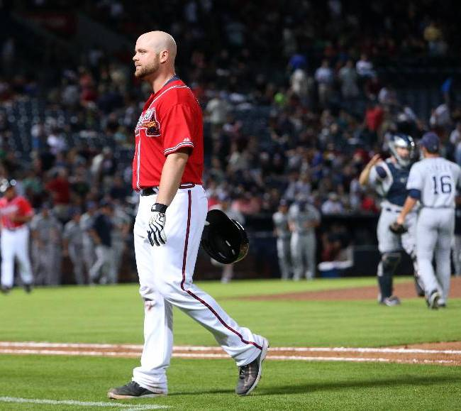 Atlanta Braves' Brian McCann walks off of the field after grounding out to end a baseball game against the San Diego Padres on Friday, Sept. 13, 2013, in Atlanta. The Padres won 4-3