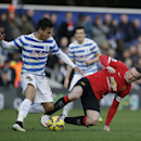 Queens Park Rangers' Eduardo Vargas, left, competes for the ball with Manchester United's Wayne Rooney during the English Premier League soccer match between QPR and Manchester United at Loftus Road stadium in London, Saturday, Jan. 17, 2015