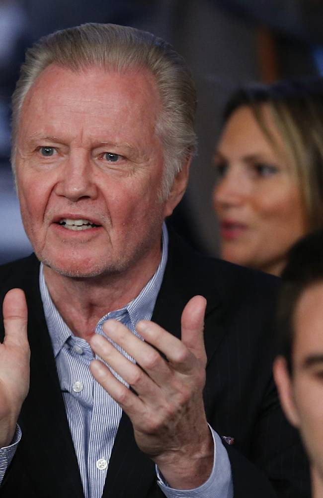 John Voight applauds as Floyd Mayweather Jr. and Canelo Alvarez enter the ring for their 152-pound title fight, Saturday, Sept. 14, 2013, in Las Vegas