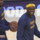 Get up close and personal with LeBron James as he gets his teammates focused for action against the Knicks.