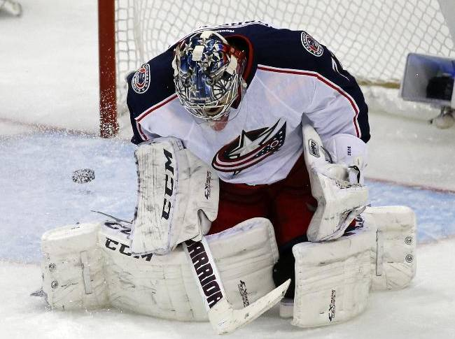 A goal by Pittsburgh Penguins' Brandon Sutter bounces out of the net behind Columbus Blue Jackets goalie Sergei Bobrovsky (72) in the third period of a first-round NHL playoff hockey game in Pittsburgh Wednesday, April 16, 2014