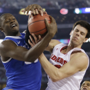 Kentucky forward Julius Randle, left, fights for a rebound with Wisconsin forward Duje Dukan during the second half of an NCAA Final Four tournament college basketball semifinal game Saturday, April 5, 2014, in Arlington, Texas. (AP Photo/David J. Phillip)