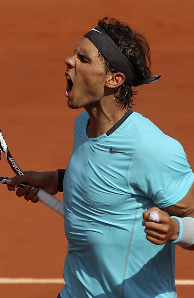 Spain's Rafael Nadal reacts as he wins  the second set against Serbia's Novak Djokovic during their final match of  the French Open tennis tournament at the Roland Garros stadium, in Paris, France, Sunday, June 8, 2014