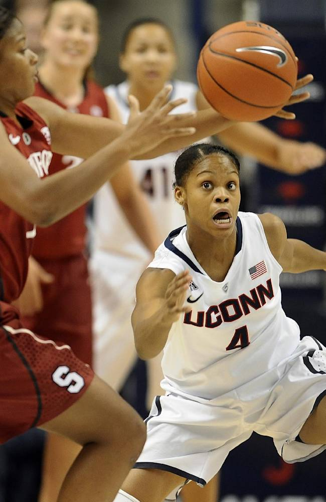 Connecticut's Moriah Jefferson, right, keeps an eye on the ball as Stanford's Amber Orrange, left, passes, during the first half of an NCAA college basketball game, Monday, Nov. 11, 2013, in Storrs, Conn