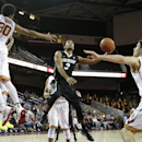 Colorado's Xavier Talton, center, puts up a shot as Southern California's Elijah Stewart, left, and Strahinja Gavrilovic, of Serbia, watch during the first half of an NCAA college basketball game, Thursday, Jan. 29, 2015, in Los Angeles. (AP Photo/Jae C. Hong)
