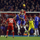Liverpool's Martin Skrtel, center top, competes for the ball with Chelsea's Gary Cahill during the English League Cup semi-final first leg soccer match between Liverpool and Chelsea at Anfield Stadium, Liverpool, England, Tuesday Jan. 20, 2015