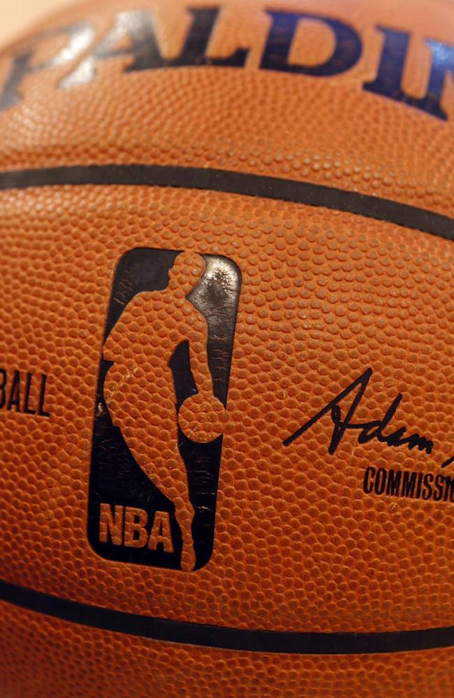 The signature of incoming NBA Commissioner Adam Silver appears on an official game ball before an NBA basketball game between the Miami Heat and the New York Knicks Saturday, Feb. 1, 2014, in New York. David Stern retired after exactly 30 years in charge, making him the NBA's longest-serving and most successful commissioner