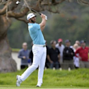 February 16, 2017; Pacific Palisades, CA, USA;  Dustin Johnson hits from the ninth hole fairway during the first round of the Genesis Open golf tournament at Riviera Country Club. Gary A. Vasquez-USA TODAY Sports