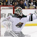 Minnesota Wild goalie Niklas Backstrom (32) gloves a shot by the Pittsburgh Penguins during the second period of an NHL hockey game in Pittsburgh on Tuesday, Jan. 13, 2015 The Associated Press