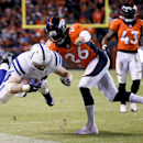 Indianapolis Colts running back Ahmad Bradshaw, left, is knocked out of bounds by Denver Broncos free safety Rahim Moore during the second half of an NFL divisional playoff football game, Sunday, Jan. 11, 2015, in Denver The Associated Press