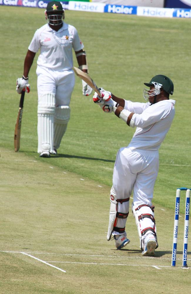 Zimbabwean batsman Vusimusi Sibanda plays a shot on the first day of the  last  test match   against Pakistan at Harare Sports Club  in Harare, Tuesday, Sept, 10, 2013. Pakistan is in Zimbabwe  to play Test matches against the hosts