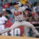 In a May 20, 2011 file photo Atlanta Braves pitcher Tim Hudson throws against the Los Angeles Angels in the first inning of a baseball game in Anaheim, Calif. The San Francisco Giants were working Monday, Nov. 18, 2013, to finalize agreement on a $23 m