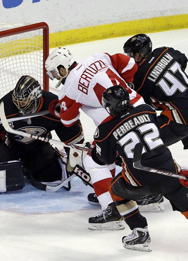 Four players line up to attack and defend the Anaheim Ducks goal, with Detroit Red Wings center Riley Sheahan (15) and right winger Todd Bertuzzi (44) facing Ducks goalie Jonas Hiller (1), of Switzerland, while Ducks center Mathieu Perreault (22) and defenseman Hampus Lindholm (47), of Sweden, defending in the third period of an NHL hockey game in Anaheim, Calif., Sunday, Jan. 12, 2014.  The Ducks won 1-0