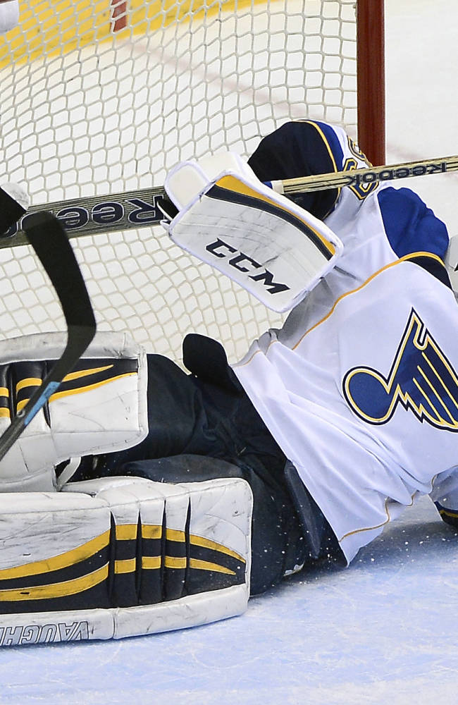 St. Louis Blues goalie Ryan Miller (39) fails to stop a goal by Nashville Predators forward Eric Nystrom in the second period of an NHL hockey game on Saturday, March 15, 2014, in Nashville, Tenn