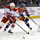 Carolina Hurricanes' Victor Rask (49) is chased by Edmonton Oilers' Boyd Gordon (27) during the first period of an NHL hockey game Friday, Oct. 24, 2014, in Edmonton, Alberta. (AP Photo/The Canadian Press, Jason Franson)