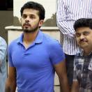 In this Tuesday, May 21, 2013 photograph, Indian cricketer Shantakumaran Sreesanth, walks towards a court in New Delhi, India. Sreesanth has denied spot-fixing after being arrested in a scandal in a domestic Twenty20 league, while he and two teammates from his Rajasthan-based team remain in police custody.  (AP Photo)