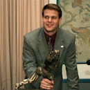 FILE - In this Dec. 14, 1996, file photo, Florida quarterback Danny Wuerffel shows off his award after he won the Heisman Trophy at the Downtown Athletic Club in New York. Wuerffel was selected to the College Football Hall of Fame on Tuesday, May 7, 2013. (AP Photo/Adam Nadel, File)