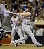 New York Mets' Daniel Murphy admires the flight of his two-run homer against the San Diego Padres in the fourth inning of a baseball game, Friday, Aug. 16, 2013, in San Diego. The Padres' catcher is Rene Rivera. (AP Photo/Lenny Ignelzi)